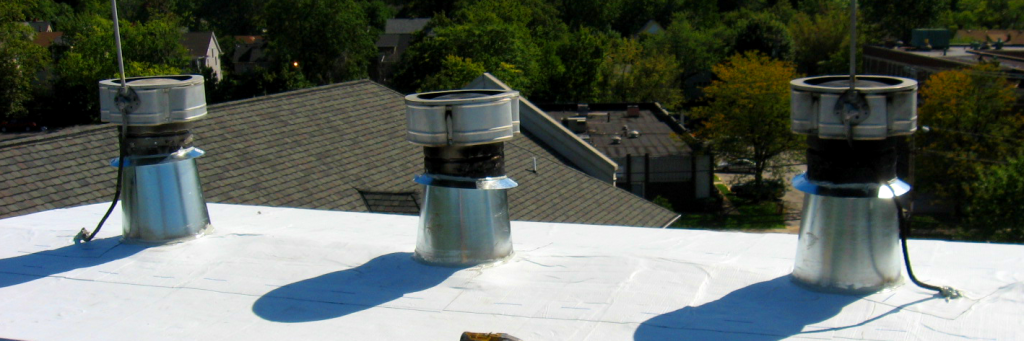 Reader Roofing working on a vents on a commercial roof.