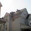 Reader Roofing crew install new roof on East Cleveland home.
