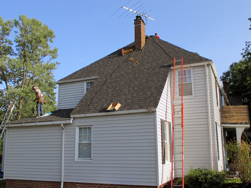 The Roofing Contractors At Reader Finish Up The Work On This Euclid Home.