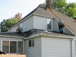 Reader Roofing Contractors Working On The Lower Roof.